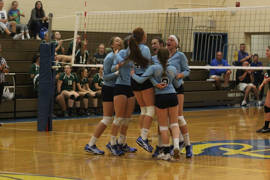 The+volleyball+team+celebrates+a+big+point+in+its+win+last+night+over+Juniata+Valley.