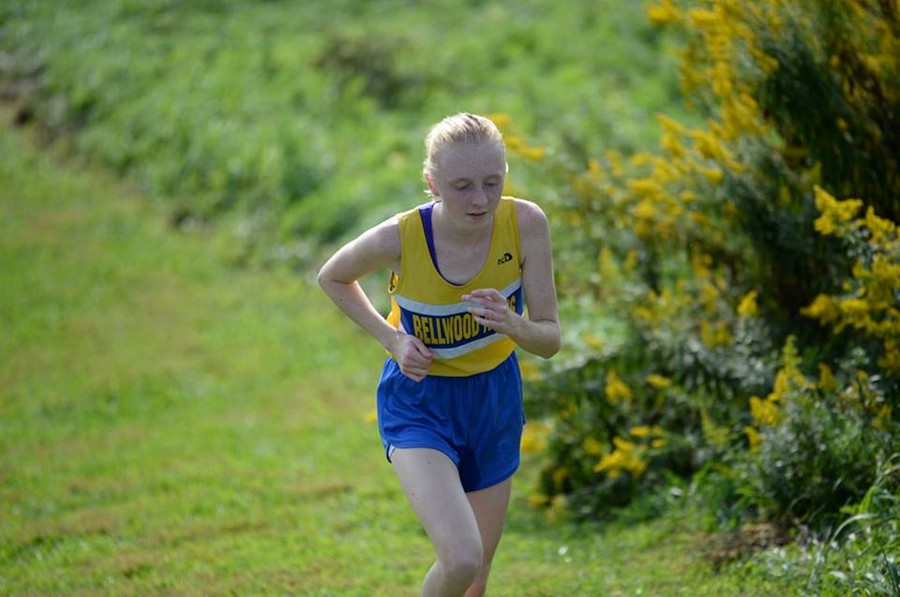 Jenna+Bartlett+rinds+it+out+up+the+challenging+hill+on+Tyrone%27s+cross+country+course.+Jenna+won+the+race+by+more+than+a+minute.