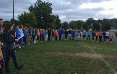 Stephanie Mills, seen in this file photo, leads the FCA in prayer at last year's See You at the Pole event.