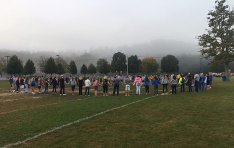 Students and community members pray together before school at See You at the Pole.