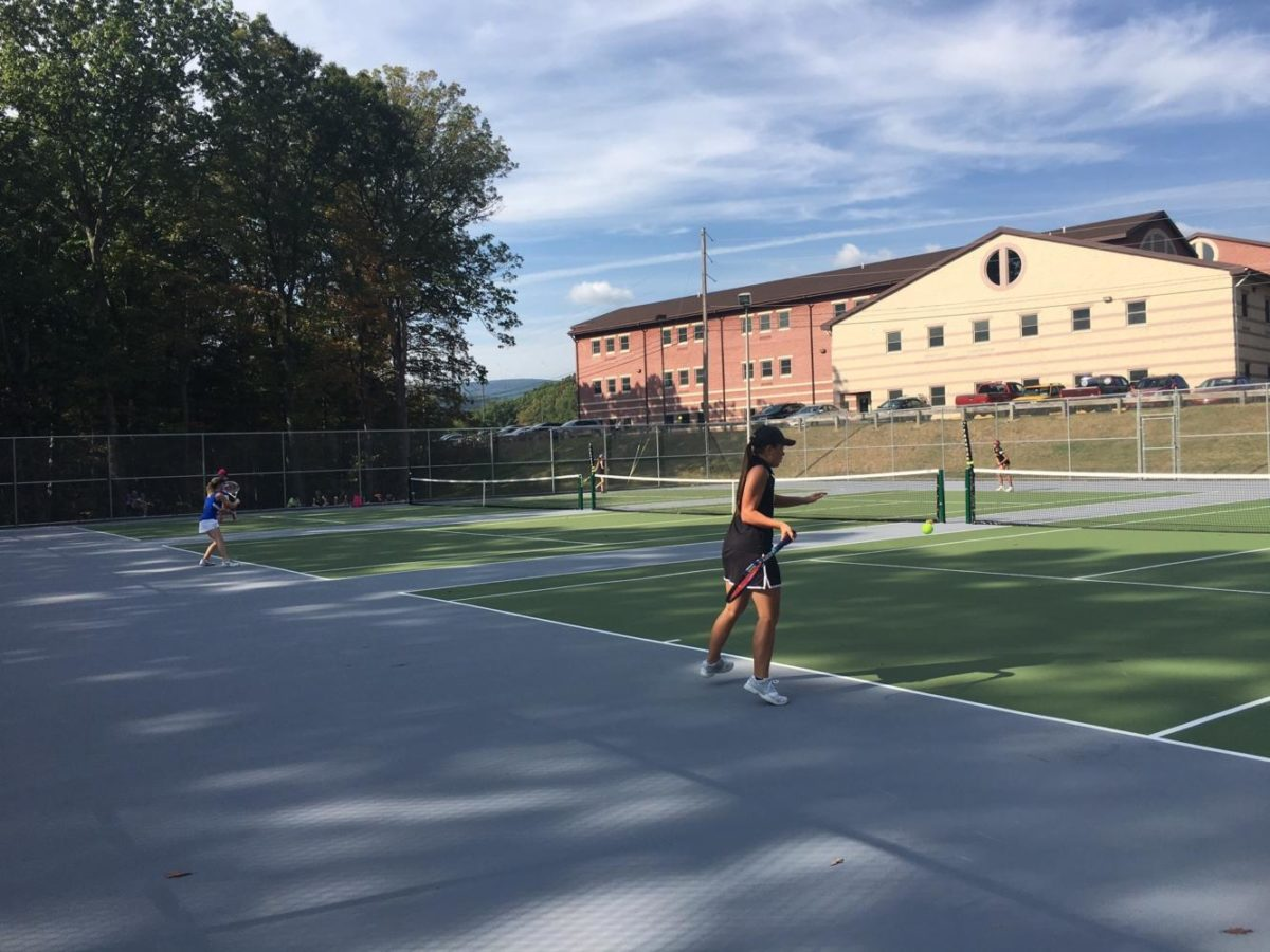 Tina+Hollen+returns+serve+against+Windber+in+another+win+yesterday.