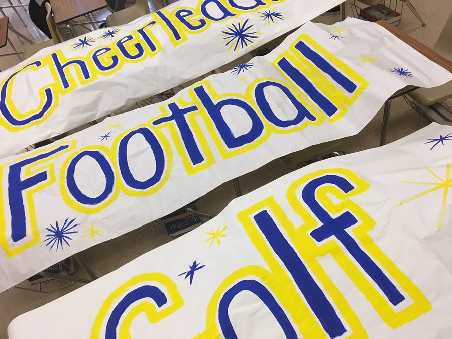 Leo Club has been hard at work creating spirit signs for all of the sports to be recognized at Friday's pep rally.