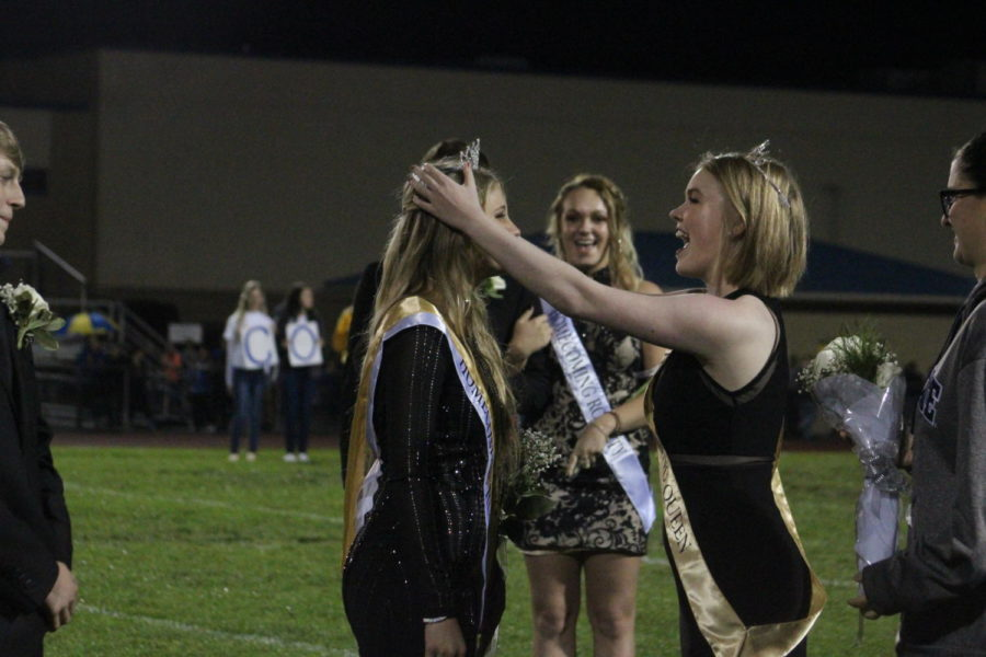 Last years homecoming queen Grace Misera handed off her crown to this years queen Shayla Branstetter.