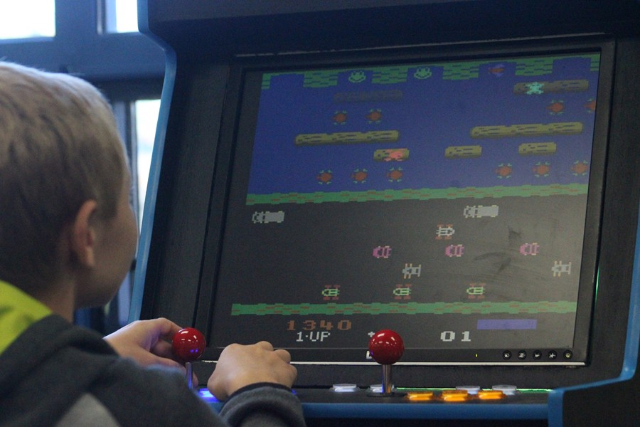 Arik Shildt plays the SWAT team video game in the media center.