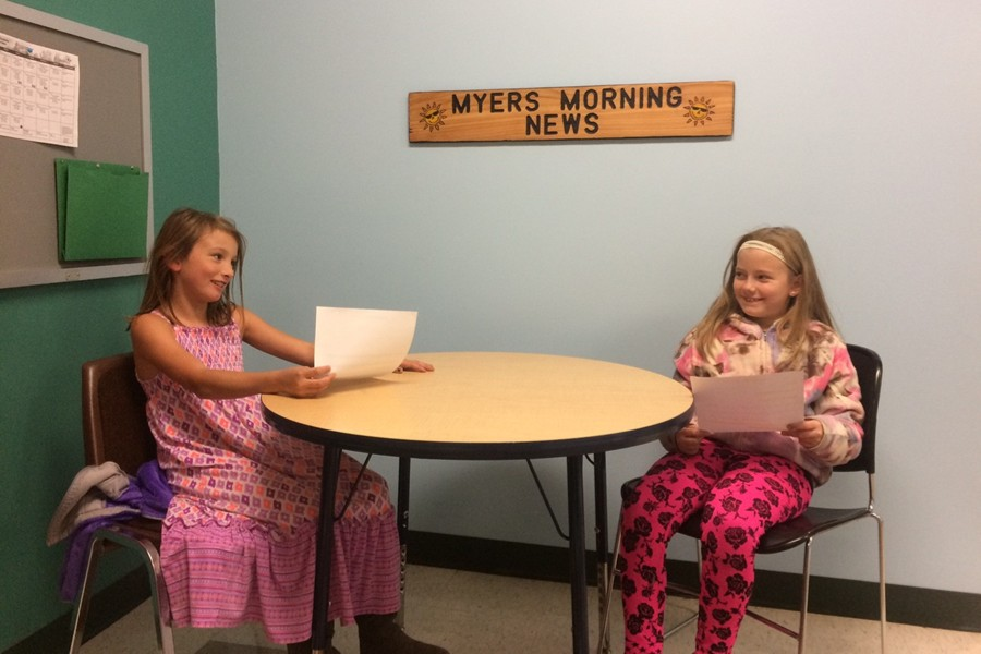 Julie and Abby prepare their script for a broadcast of Myers Morning News.
