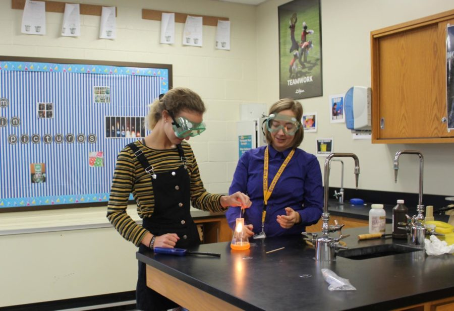 Ms.+Carrie+Clippard+works+with+Brenin+Abbot+on+a+chemistry+experiment.+Ms.+Clippard+is+happy+to+hear+of+an+increased+emphasis+of+STEM+funding.