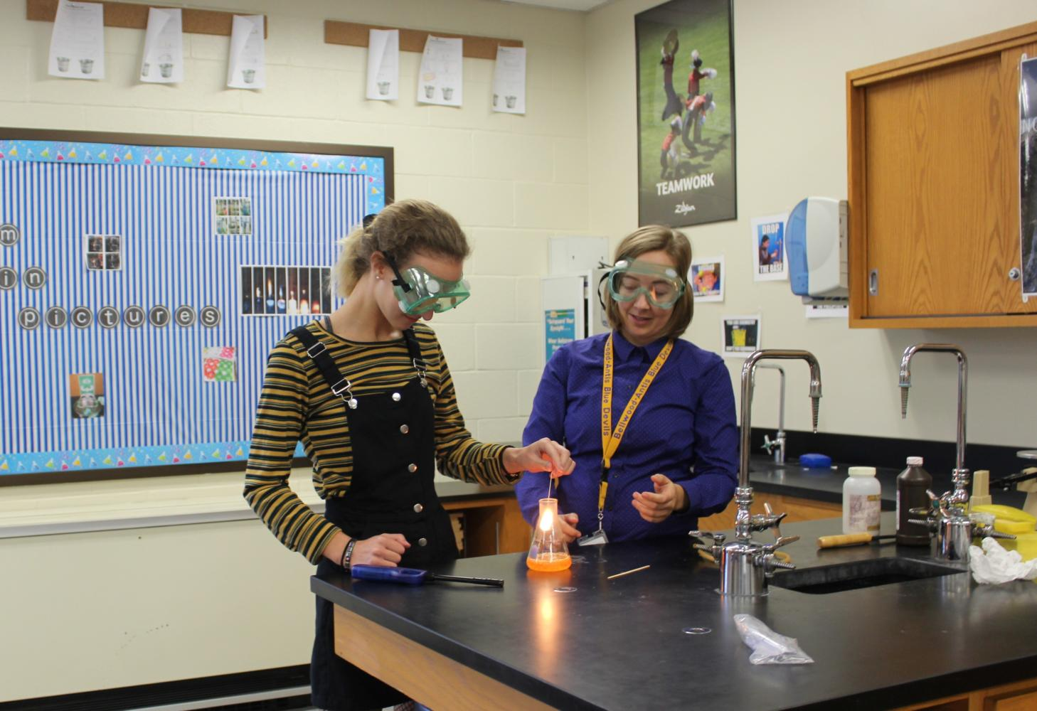 Ms. Carrie Clippard works with Brenin Abbot on a chemistry experiment. Ms. Clippard is happy to hear of an increased emphasis of STEM funding.