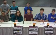 Scholastic Scrimmage team members: front row (l to r) Dan Kustaborder, Hannah Hornberger, Braden Heisler, and Robert VanKirk; back row (l to r): Caden Nagle, Paulino Cuevas and Philip Chamberlin.