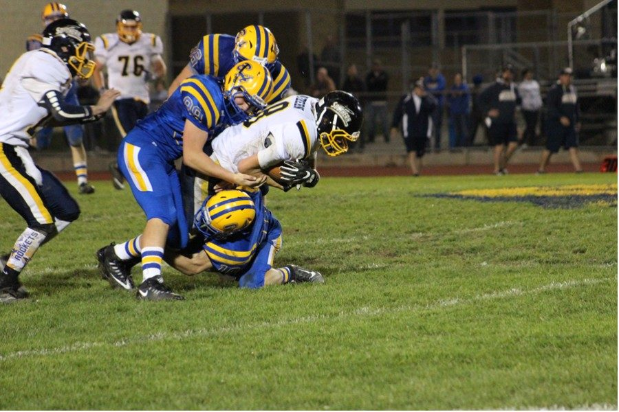 The Blue Devils football team has adopted a tackling philosophy of going low and wrapping the legs in order to make the sport safer.