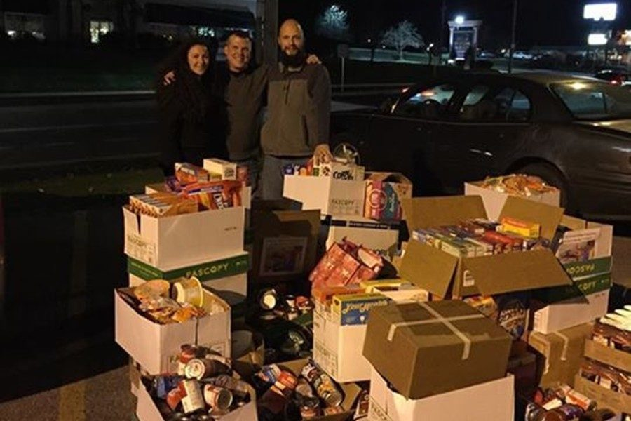 Middle school teacher Lindsey Christine, Cluster II head Todd Russell, and BAEA Vice-President Patrick Sachse take a time out before delivering donations to the St. Vincent DePaul Food Pantry.