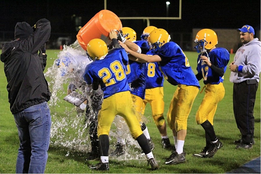 Coach Burch receives a water bucket shower at the end of the game last week. B-A defeated Southern Huntingdon to finish the season undefeated and win the ICC title.