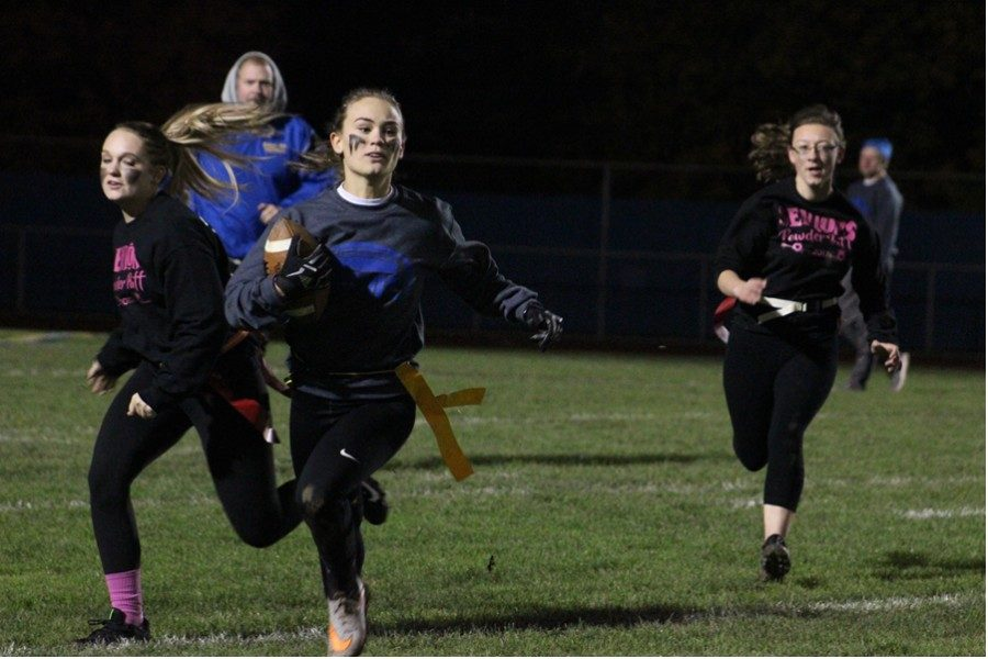 Bryne Swogger tight-ropes the sideline with Lexi gerwert and Kaitlyn Farber in pursuit.