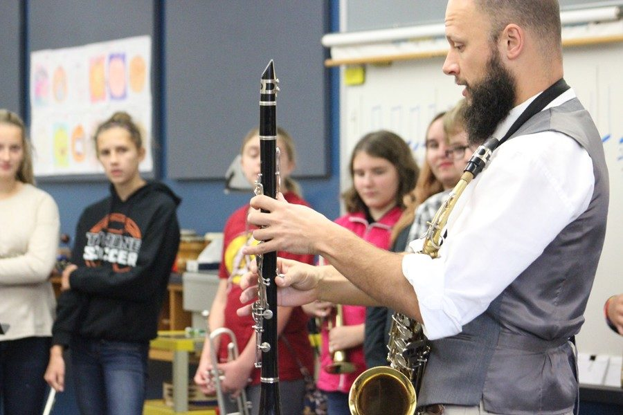 Mr. Sachse demonstrates finger positioning on the clarinet.