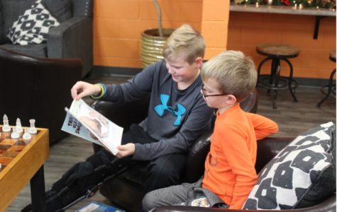 Sixth graders team with first graders on Christmas reading project