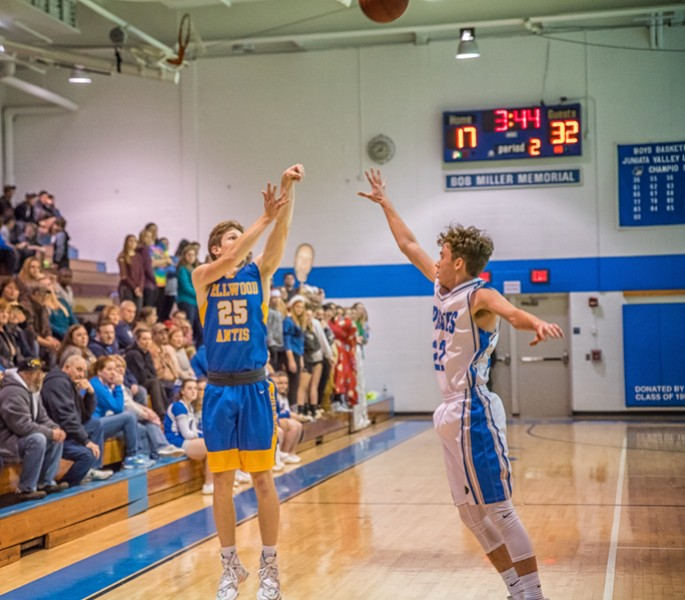 Trent Walker shoots for three of his 46 points against Williamsburg.