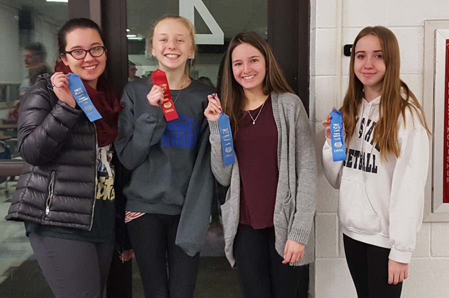 The+speech+team+took+home+four+ribbons+Tuesday+froma+meet+at+Blacklick+Valley.+From+left+to+right%3A+Hannah+Hornberger%2C+Jenna+Bartlett%2C+Alivia+Jacobs%2C+and+Haley+Campbell.
