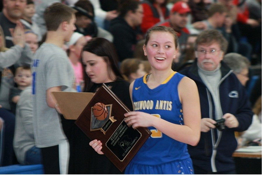 Tina Hollen accepts the ICC championship trophy after the Lady Blue Devils' 55-53 victory in the title game at Claysburg-Kimmel High School.