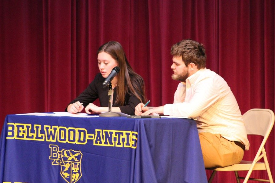 Tina Hollen and Jack Showalter look on during their debate at the annual school-wide debates