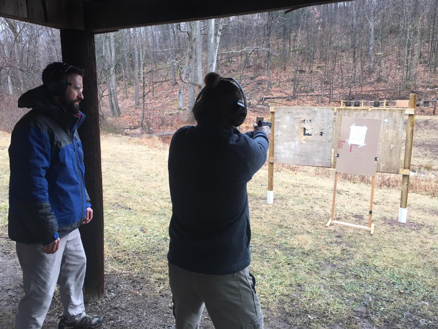 Mr. McNaul finishes up his last-minuyte tips to Mr. Naylor as they shoot at the Blair County Game, Fish and Forestry Association.