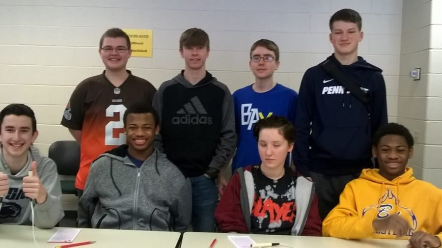 The 2018 Scholastic Scrimmage team includes Caedon Poe, Alex Taylor, Emma Corrado, Aiden Taylor, Zach Amato, Kenneth Robinson, John Sloey, Zach Mallon.