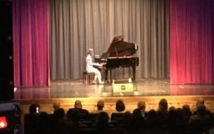 Malia Danish plays piano at the 2017 Variety Show.