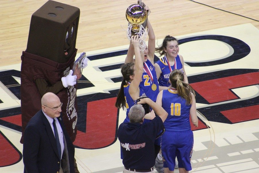 The Bellwood-Antis girls basketball team celebrates its 45-42 victory over West Catholic in the PIAA 2A championship game by hoisting the gold ball.