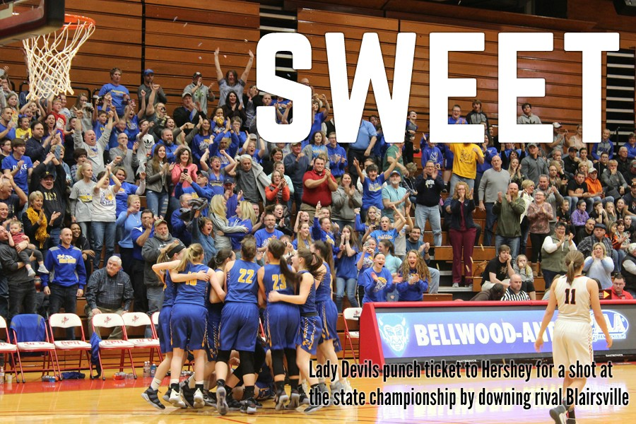 The Lady Blue Devils and their fans go wild after the closing seconds tick off of B-A's 41-36 victory over Blairsville.