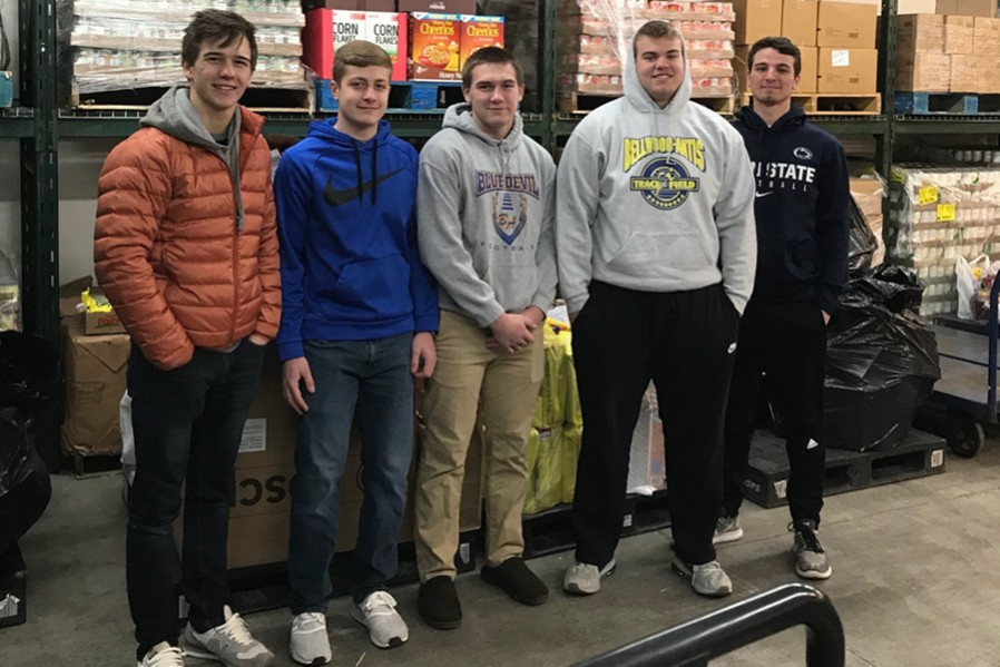 FCA+members+Tanner+Worthing%2C+Dylan+Wilson%2C+Jordan+Moore%2C+Chris+Wertman+and+Max+DeArmitt+helped+deliver+1%2C000+cereal+boxes+to+the+food+pantry.