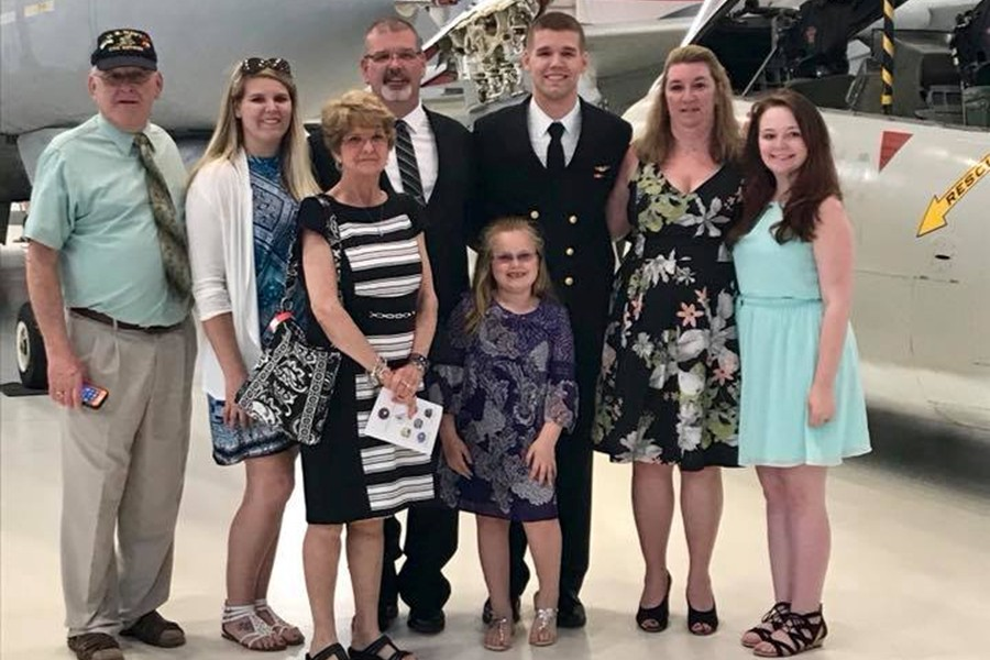 B-A grad Adam Davensizer, shown here with his family, recently received his US Navy Wings of Gold.
