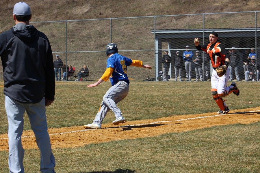 Trentin Whaley tries to elude Tyrone catcher Cory Lehman in a rundown in B-A's game Saturday against the Golden Eagles.