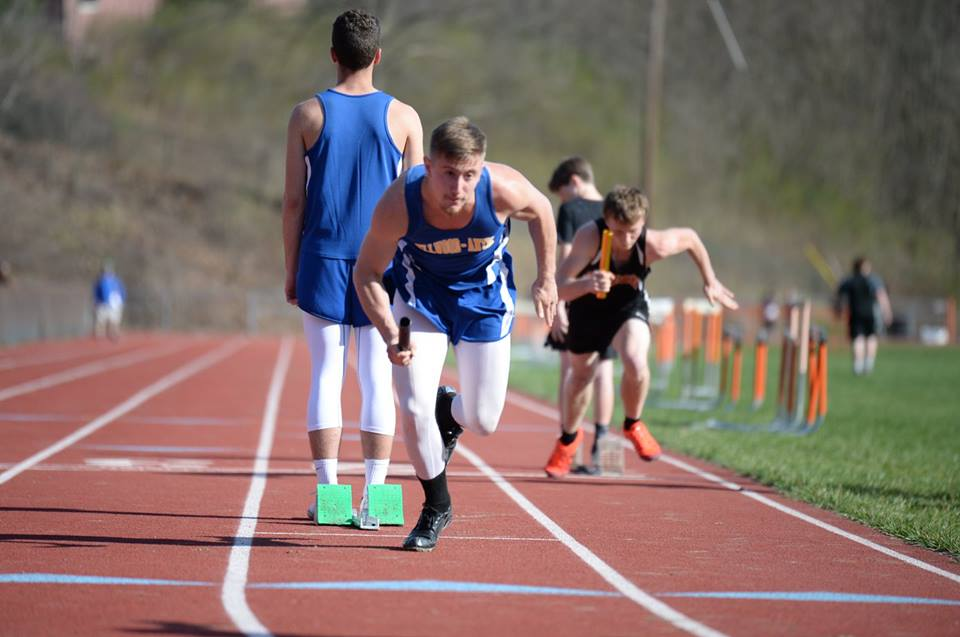 Nick Watters sets out as the first leg in the 4X100 relay yesterday against Tyrone.