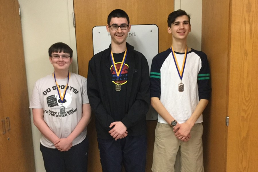 Zion Poe, center, was crowned the Chess Club tournament champion with a win in the championship finals. Pictured with him are runner-up Phillip Chamberlain (left) and third-place finisher Quintin Nelson (right).