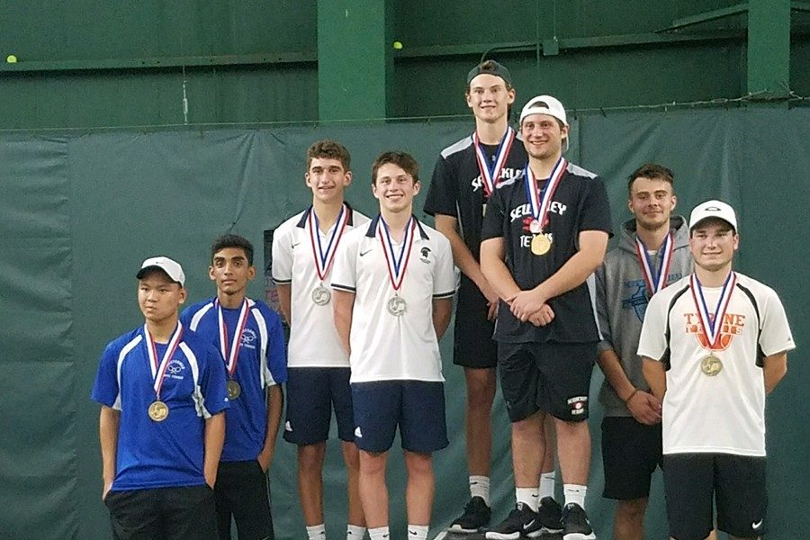Paul Lemaire and his teammate Ethan Vipond recieve their third place metal at the PIAA 2A State Tennis Tournament.
