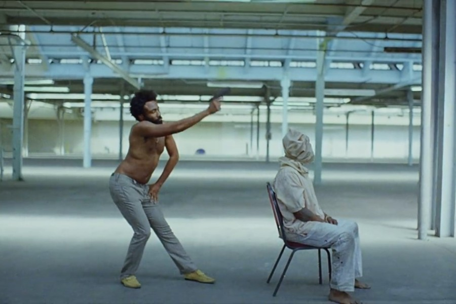 The first 55 seconds of the song This is America set the tone for a moving music video.