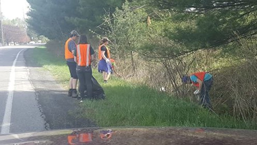 The band helped clean off a section of highway near the high school last weekend.