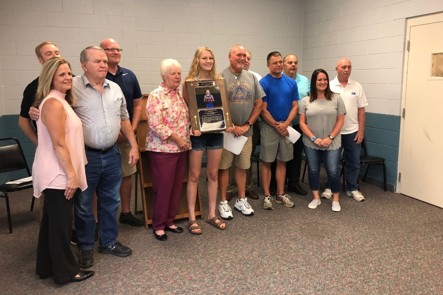 Alli Campbell was flanked by family, coaches and friends when she donated her $1,000 Play it Forward grant to the Northern Blair County Recreational Center..
