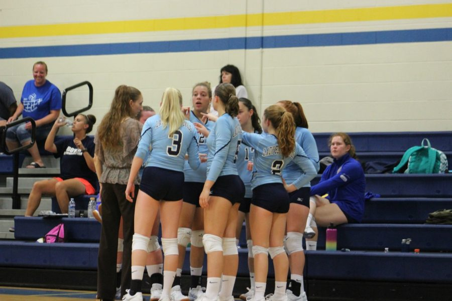 The volleyball team huddles during points against West Branch.