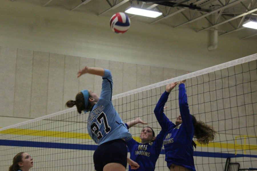 Hope Shook goes up for the kill.  (Alex Frederick)