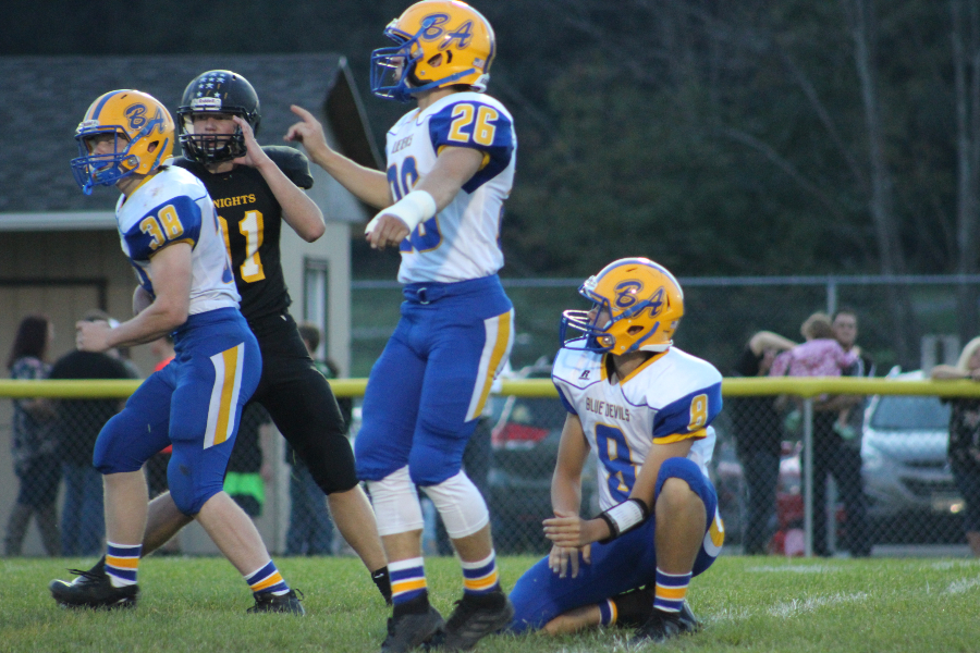 Alex Schmoke finishes his extra-point kick against Moshannon Valley.