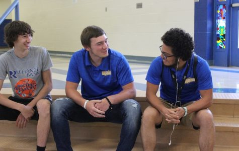 Jordan Moore (center), talks with Mason Yingling and Alex Frederick in school the day of his return to the gridiron. Jordan suffered a broken pelvis and other injuries from a near-fatal car crash in May.