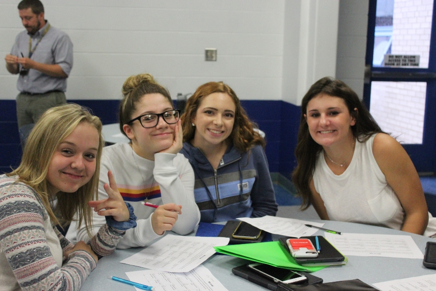 Kaitlyn Dickinson, Isabella Barbosa, Sydney Lechner and Caitlyn McCartney make plans at Aevidum club.