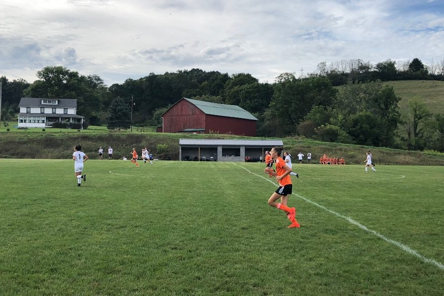 Freshman Sophia Nelson heads up the field against Clearfield.