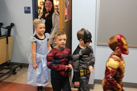 Students have a chance to dress up and trick or treat with their school friend