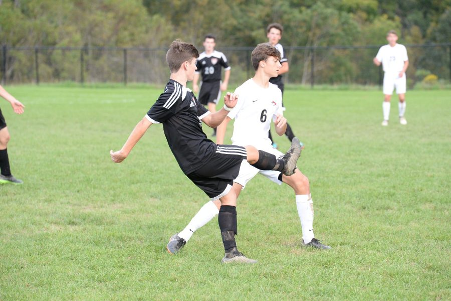 Corey Johnston scored two goals and had two assists in the soccer team's win over Central.