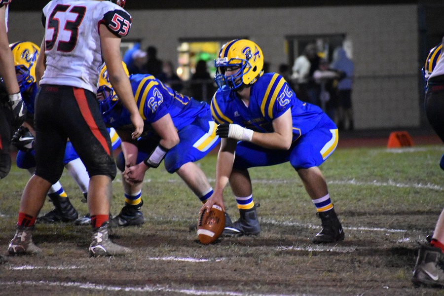 Trenton Gonder gets ready to snap the ball against Tussey Mountain.