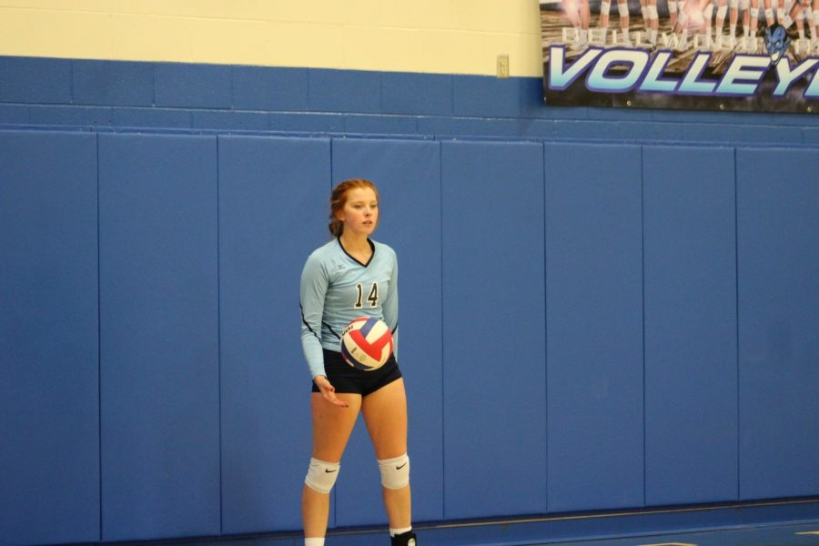 Karlie Feathers waits to serve the ball against Northern Bedford.