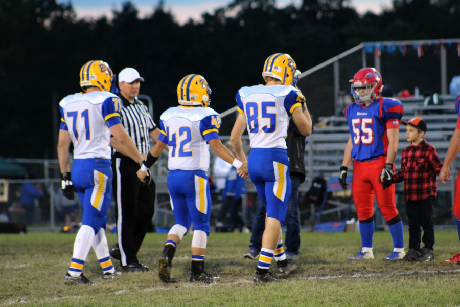 B-A captains head out for the coin toss before their game against West Branch.