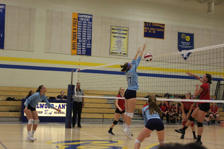 Hope Shook goes for the block against Tussey Mountain.