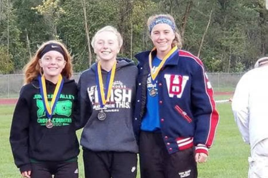 Jenna+Bartlett+%28center%29+poses+with+Juniata+Valley%27s+Morgan+Hess+and+West+Branch%27s+Hailey+Prestash.+The+trio+took+the+top+three+spots+at+the+ICC+cross+country+meet+yesterday%2C+with+Bartlett+earning+silver.