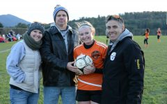 Riley DAngelo celebrates her record-setting goal with her parents and coach.